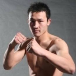 """Guan """"The Dongbei Tiger"""" Wang"""